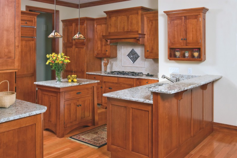 mission style kitchen design with red wood materials red wood floors and marble countertop