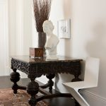 modern entryway table angular chair sculpture carpet hardwood floors glass vase framed artwork traditional design