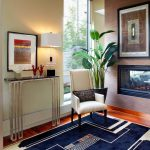modern entryway table hardwood floors carpet tall back chairs fireplace framed artworks lamp vases contemporary design