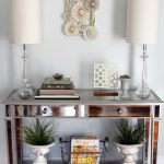 modern entryway table lamps wall decorations ceramic pots metal basket hardwood floors eclectic design