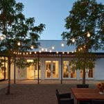 Modern Farmhouse With Wooden Pergola For Patio A Set Of Outdoor Furniture
