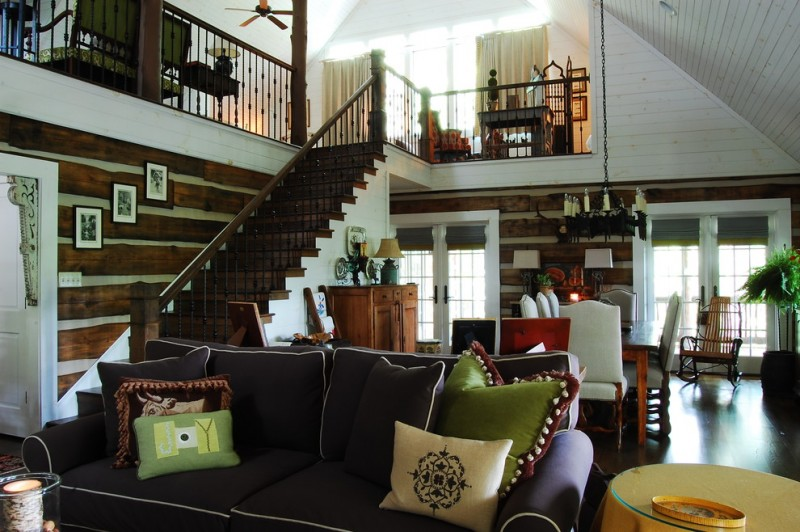 mountain home floor plans medium wood flooring dark brown couch wood staircase and iron railings white painted wood ceiling glass window with valances white cushioned dining chairs with wooden table