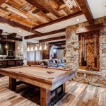 mountain home floor plans wood flooring stones wall abstract wood ceiling nice chandelier rustic kitchen area