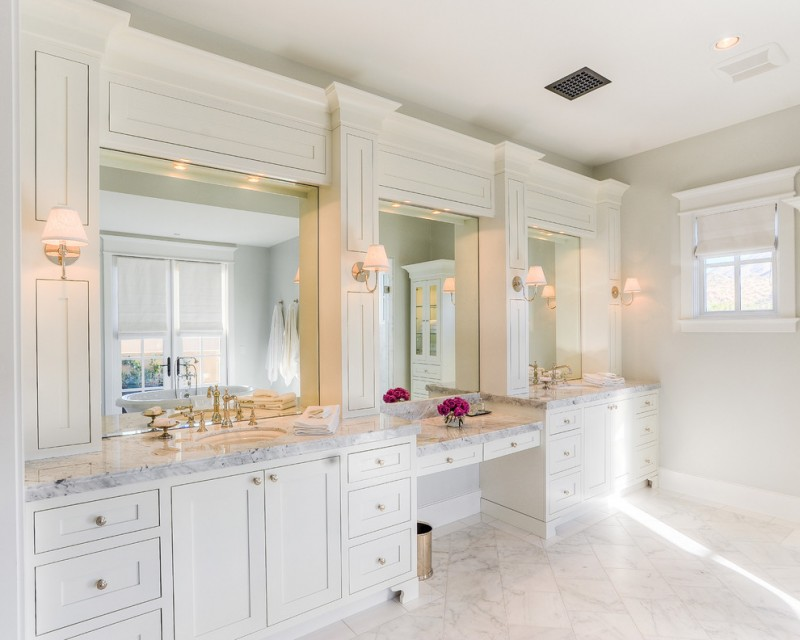 nate berkus furniture light wall sconces bathroom vanities brass faucets mirrors drawers ceiling lights window marble floor transitional design
