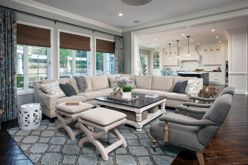 nate berkus furniture sectional sofa armchairs stools coffee table carpet hardwood floors pendants ceiling lights white cabinets island sidetable traditional design