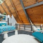 Natural Wood Ceilings Glass Skylight Steel Ceiling Supports Blue White Bedding Idea Dark Grey Tiles Floors Blue Couch White And Round Area Rug