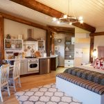 One Bedroom Cabin Plans Bed Chaise Longue Cabinets Kitchenette Pendants Light Fixture Dining Table Chairs Hardwood Floors Carpet Sink Headboard Rustic Design
