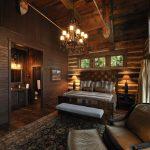 one bedroom cabin plans bed chaise longue foot rest plank walls carpet dark hardwood floors chandelier cabinet light fixtures rustic design