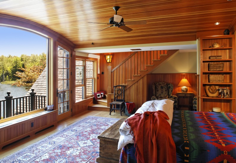 one bedroom cabin plans hardwood floors carpet bookshelf window wall ceiling lights bed fan wood stairs ottoman chair couch table rustic design