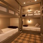 One Bedroom Cabin Plans Lofted Bunk Beds Light Fixtures Beige Walls Carpet Ceiling Lamps Drawers Rustic Design