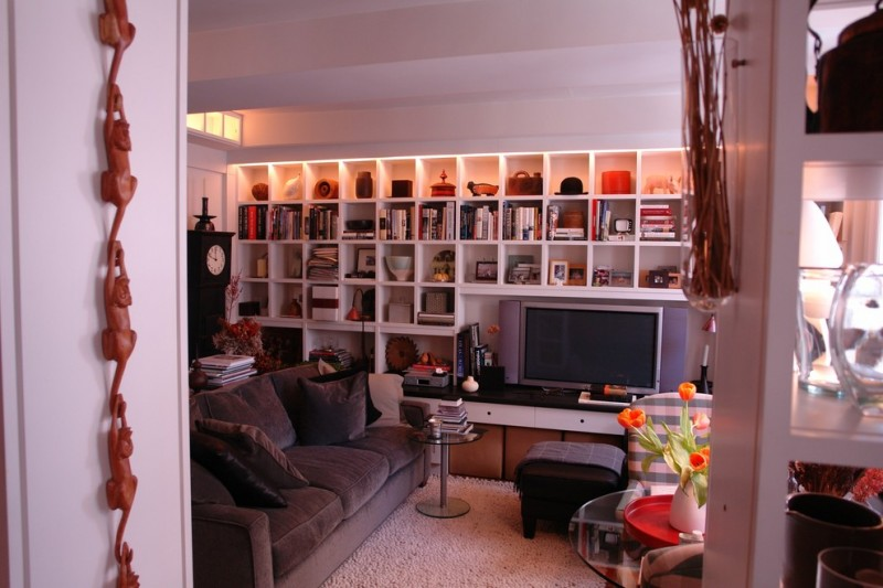organization ideas for small spaces custom built in shelving sidetable round table sofa upholstered ottoman tv wall decorations eclectic design