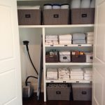 Organizational Ideas For Small Spaces Linen Closet Divisions Hardwood Floor Baskets Towel Double Window Traditional Design