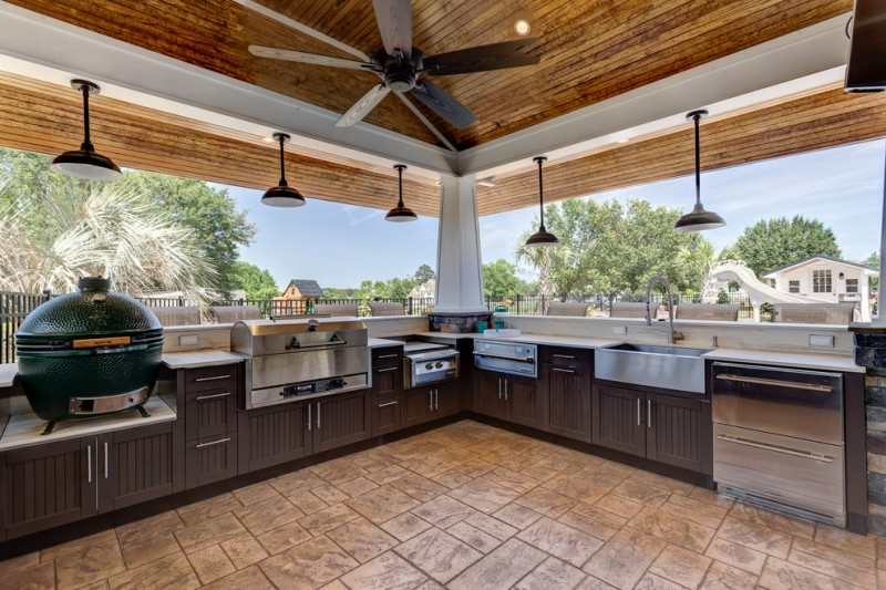 outside kitchen design cabinets stove lamps ceiling fan faucet sink beach style patio