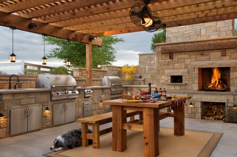 outside kitchen design fireplace faucet hanging lamps carpet table bench firewood decorative plant farmhouse patio