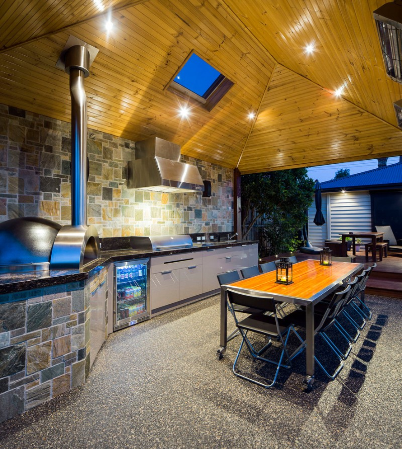 outside kitchen design stove small fridge dining area table chairs ceiling lights cabinet contemporary style