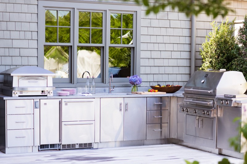 outside kitchen design stove window flowers cabinet drawers sink traditional patio
