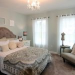Paris Inspired Bedroom Bed Pillows Wall Decors Curtains Chair Blanket Small Tables Chandelier Traditional Style Room