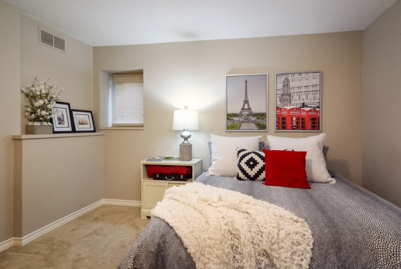 paris inspired bedroom big bed blanket bedside table lamp flowers pillows small window transitional bedroom