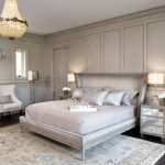Paris Inspired Bedroom Carpet Dark Floor Bed Pillows Flowers Bedside Tables Lamps Chair Transitional Room