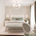 Paris Inspired Bedroom Wood Floor Chair Bed Pillows Bedside Tables Lamps Floral Patterns Blanket Chandelier Traditional Style