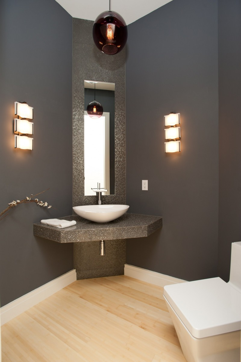pendant light mosaic tiled wall grey wall bowl vessel sink wall lights light wood floor rectangular toilet