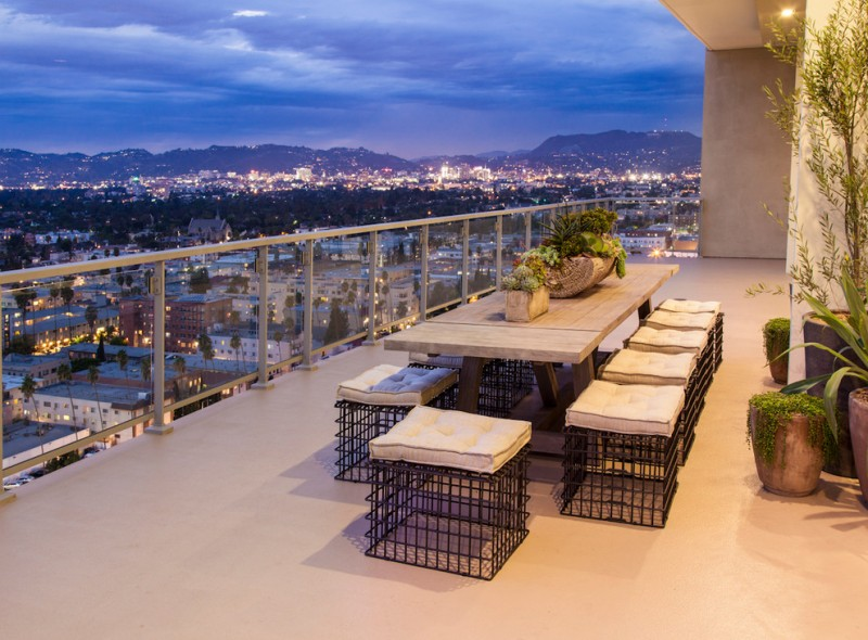 penthouse in los angeles seating table ceiling light decorative plants contemporary balcony