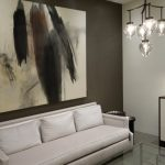 penthouses in los angeles sofa glass top table painting lamp cabinet chandelier contemporary living room
