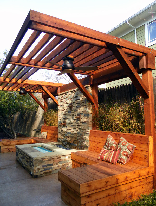 redwood pergola idea with redwood pergola seating installations veneer stone side table concrete floors a couple of ceiling fans