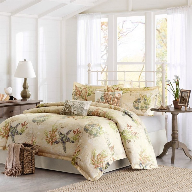 sand colored base comforter and shams with coastal theme textured beige area rug white walls white ceramic floors