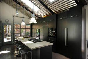 slopped ceiling flat panel cabinet black cabinet black appliances black island light countertop stainles steel bar stool ceiling lights