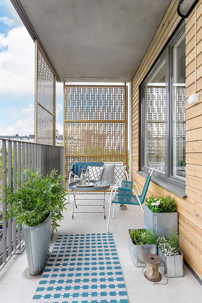 small balcony with aluminium rail, glossy plants pot, aluminium bench and couch and coffee table, sliding wooden perforated screens