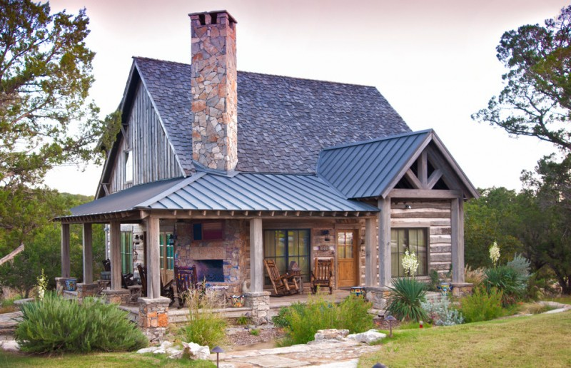 small rustic house plans rocking chairs pillars roof doors window stone grass fireplace outdoor area wood walls exterior