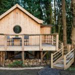 small rustic house plans stairs railings wooden walls round window chairs table exterior