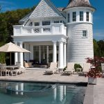 small victorian house plans pool tower balcony gable roof lounges chairs patio deck sunbrella pavers victorian design