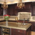 spanish tile backsplash dura supreme cabinetry sub zero wine storage cooler decorative tiles beautiful gold chandeliers granite countertop
