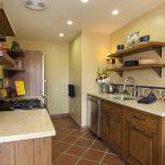 Spanish Tile Backsplash Hand Painted Spanish Tile Backsplash Limestone Countertops Open Wood Shelves Rustic Walnut Cabinetry