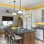 spanish tile backsplash yellow painted wall nice one line spanish baksplash tile white compact cabinet wood island with chairs