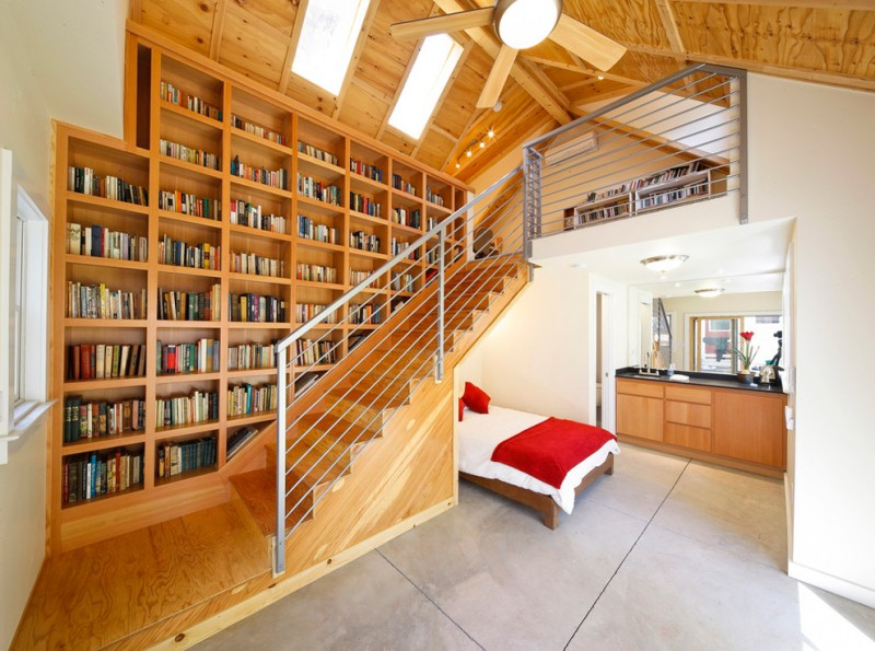 stair step bookcase books shelves bookshelves stairs window bed ceiling fan with lighting lamps contemporary bedroom