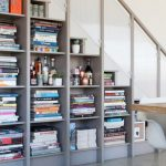 stair step bookcase bookshelves books stairs chairs table contemporary staircase