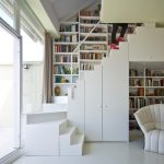 stair step bookcase bookshelves books stairs seating lamp curtain contemporary staircase