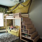 stair step bookcase dark coloured floor carpet books shelves couch bed lamp contemporary kids room