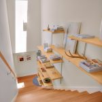 stair step bookcase stairs shelves books painting white walls modern staircase
