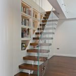 stair step bookcase wood floor stairs shelves books glass contemporary staircase