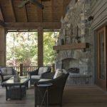 Stone Outdoor Corner Fireplace Black Rattan Chair Sets Wooden Deck Floor Ceiling Wooden Framed Glass Door