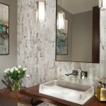 tiled wall pendant light wall mirror picture floating countertop wooden vanity lighted sink floral arrangement