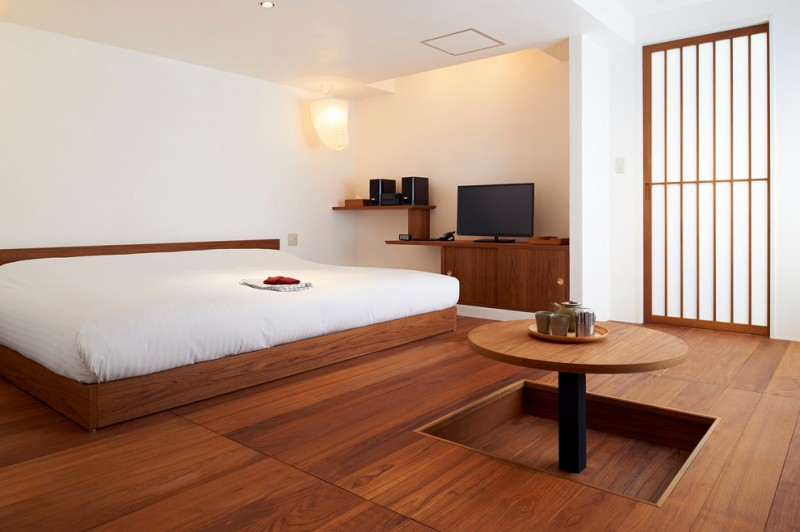traditional japanese bed wood floor built in table tv speakers lighting asian bedroom