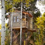 treehouse for kids spiral staircase wood exterior lamps rooftop area balcony windows rustic design