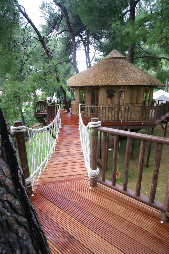 treehouses for kids bridge deck round roof windows door rope railing eclectic design
