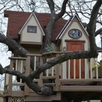 treehouses for kids gable roof door window balcony railing light fixtures eclectic design