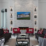 wall decorating ideas for living room sofas armchairs sidetable table tv fireplace textured wall tv built in display shelves ceiling lights contemporary design
